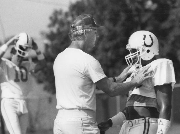 Colts assistant coach Chip Meyer instructs Tony collins on a move during Colts camp in 1988.