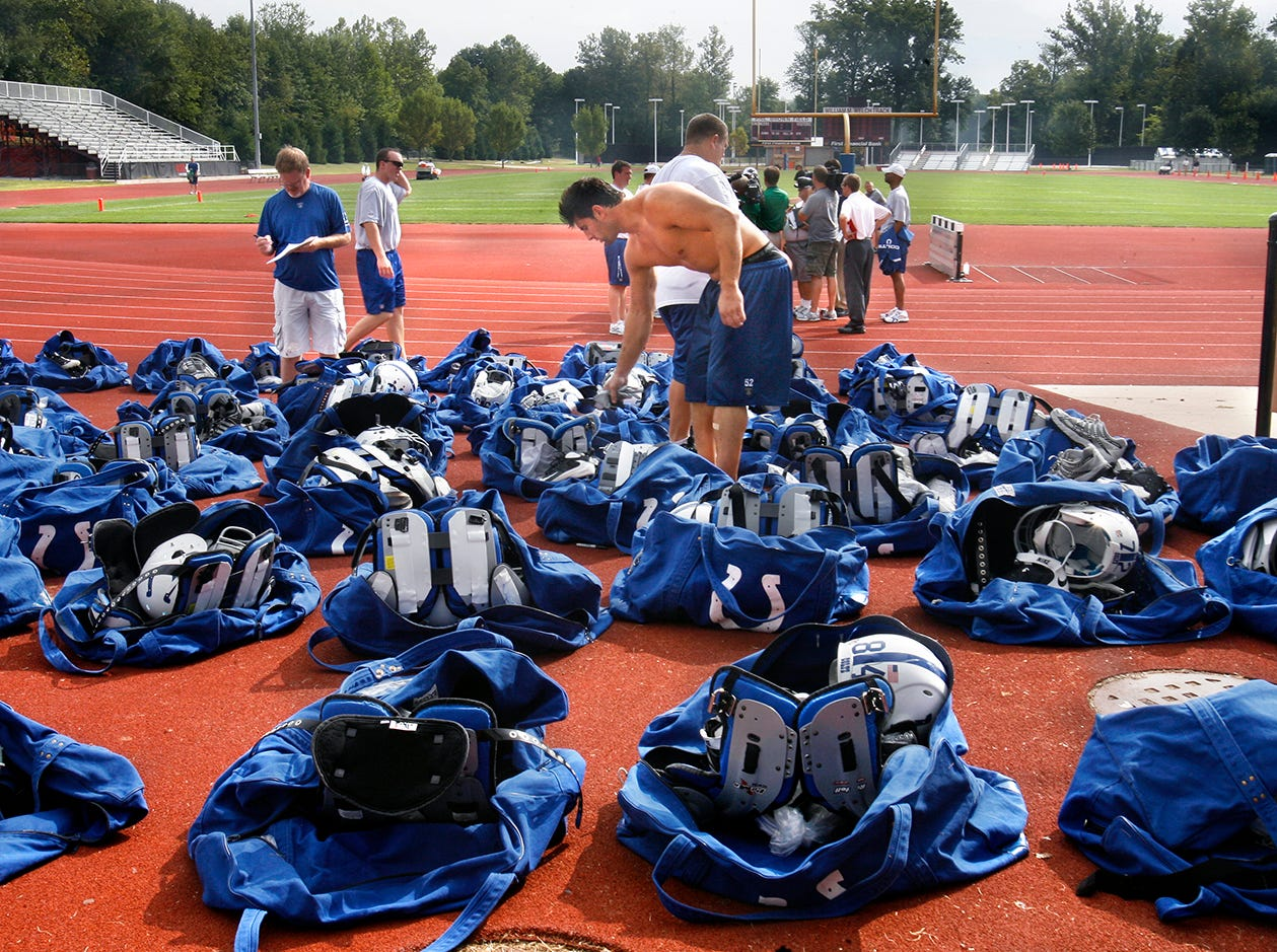 Indianapolis Colts 6th-year linebacker Adam Seward, center, drops his shoes into his bag after the final Colts training camp practice at Rose-Hulman Institute of Technology in Terre Haute on Wednesday, August 19, 2009. The Colts will host the Philadelphia Eagles in a preseason game Thursday night at Lucas Oil Stadium.