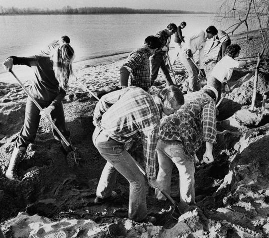 FBI agents scour the sand of a beach of the Columbia River, searching for additional money or clues in the 9-year-old D.B. Cooper skyjacking case, Tuesday, Feb. 13, 1980, Vancouver, Canada. Brian Ingram, 8, found several thousand dollars of the Cooper money. (AP Photo/Reid Blackburn)