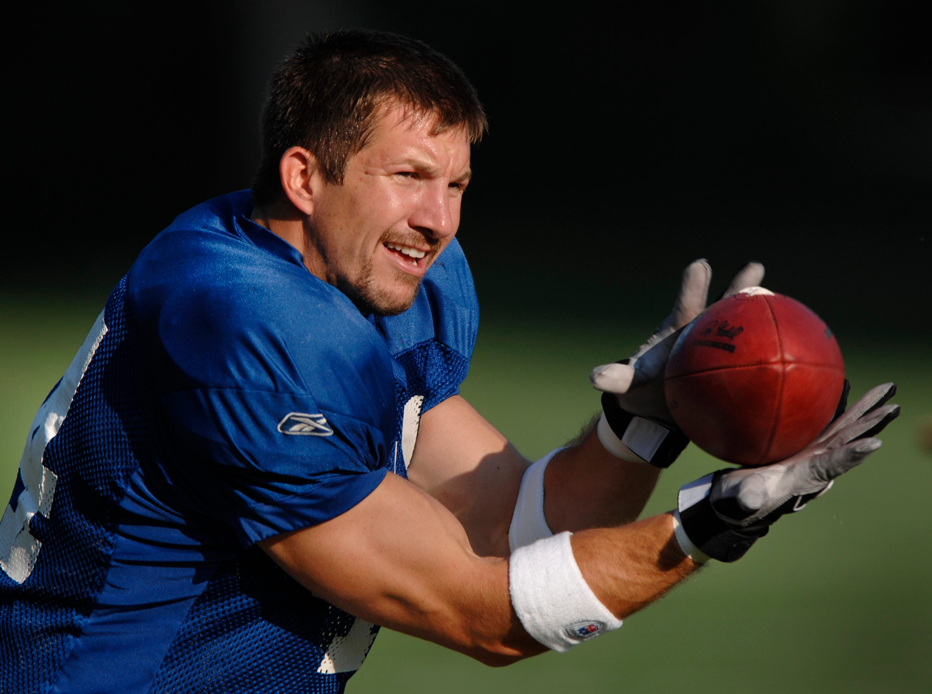 Dallas Clark catches a practice pass during morning practice at Colts training camp at Rose Hulman Institute of Technology in Terre Haute, IN on Monday, July 30, 2007 in Terra Haute, IN.