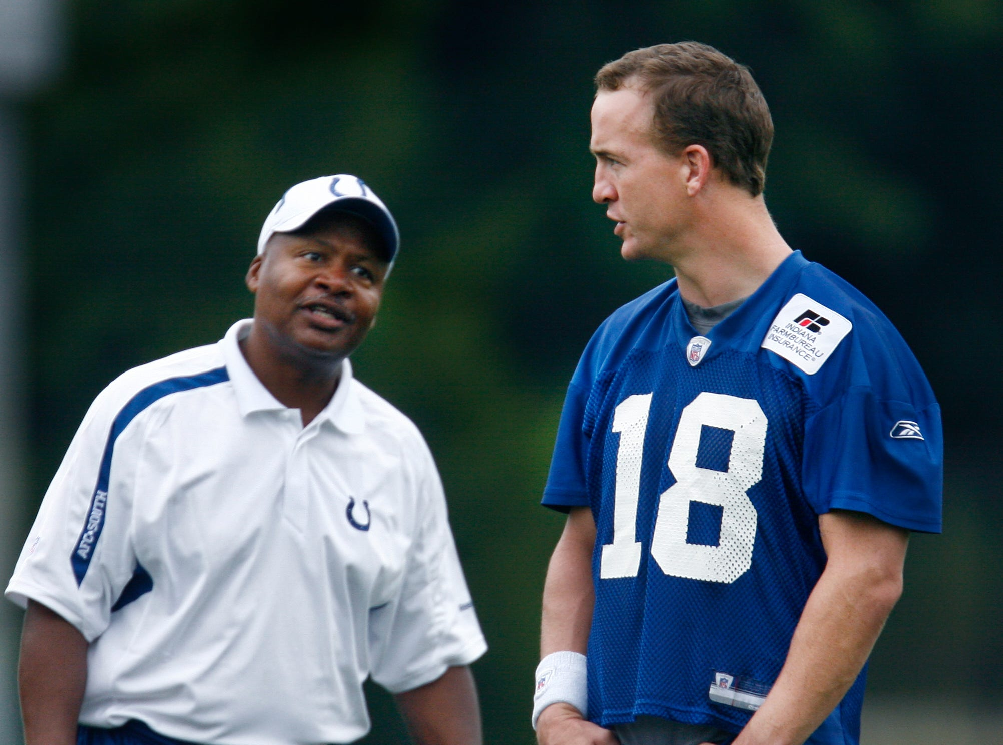 Indianapolis Colts Head Coach Jim Caldwell and quarterback Peyton Manning talk on the field before the team's light one-hour final training camp practice at Rose-Hulman Institute of Technology in Terre Haute on Wednesday, August 19, 2009.