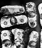 Part of the money that was paid to legendary hijacker D.B. Cooper in 1971 is shown during an F.B.I. news conference, Feb. 12, 1980, where it was announced that several thousand dollars was found 5 miles northwest of Vancouver, Wash., by Howard and Patricia Ingram and their 8-year-old son Brian on Feb. 10.  The couple's son found the money while on a family picnic.  (AP Photo/Eric Risberg)