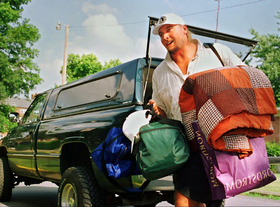 #79 offensive lineman Tony Mandarich  unpacks Monday afternoon as Colts training camp opens on the campus of Anderson University.  Mandarich,  a former #2 pick in the draft, was later described in a Sports Illustrated  cover story as a bust.  This will be MandarichÕs first training camp since 1992 when he played for the Green Bay Packers and he said that one of his main  goals  for the season is to have fun.
