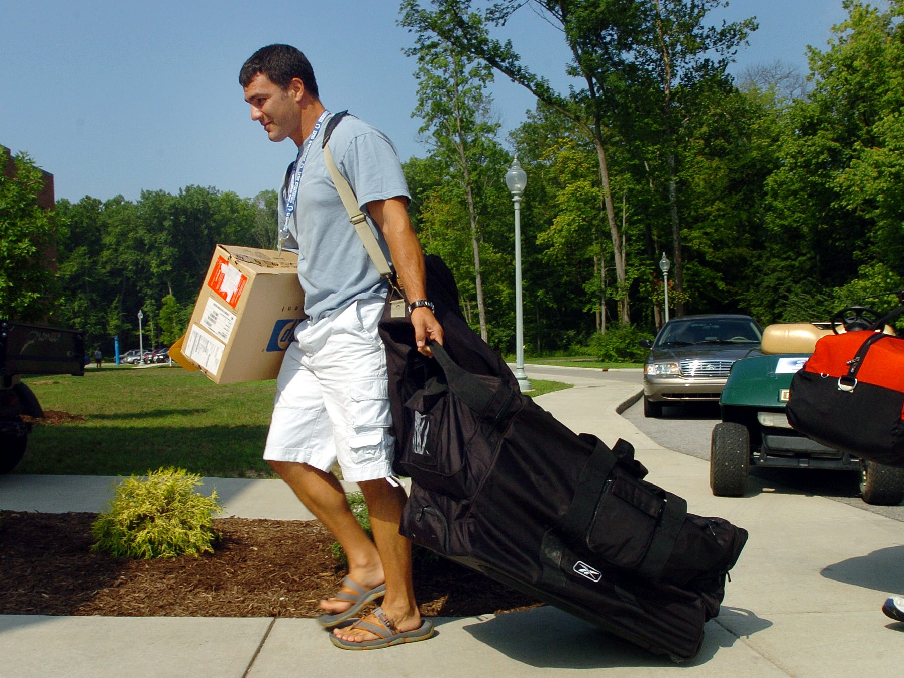 7/30/06 --- Indianapolis Colts kicker Adam Vinatieri hauls in his camp gear as he and  the Colts reported to camp Sunday afternoon at Rose-Hulman Institute of Technology in Terre Haute.