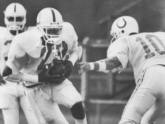 Colts running back Eric Dickerson, left, takes a handoff from quarterback Jack Trudeau at training camp in 1988.
