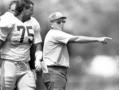 Colts offensive line coach Bill Muir directs players during an afternoon session of training camp at Anderson university in 1991.