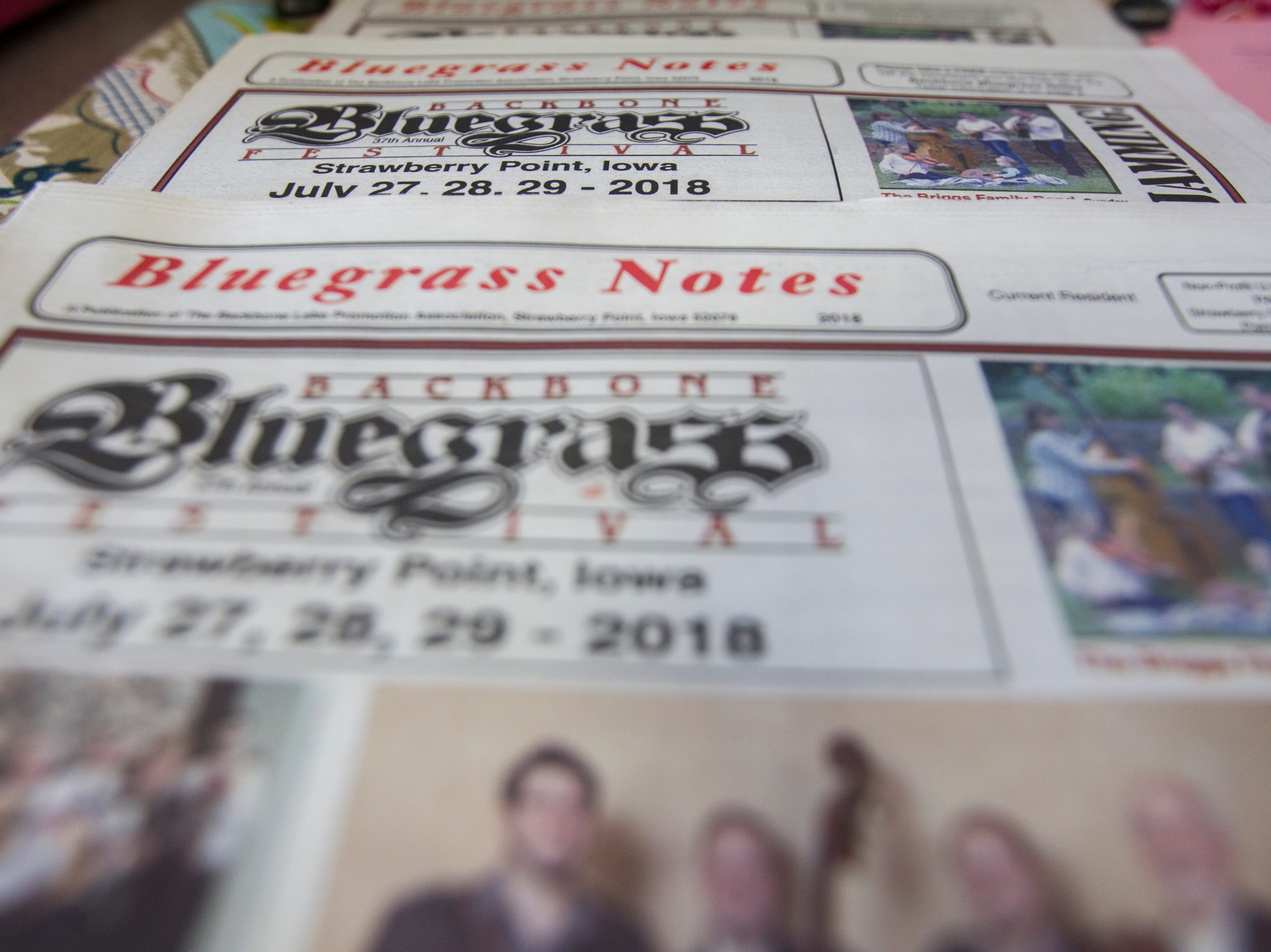 """Items are seen on a table with merchandise for the Savage Hearts trio during a free """"Learn to Jam Bluegrass Workshop"""" on Wednesday, July 25, 2018, at West Music in Coralville, Iowa. Savage was joined by the other two members of the Savage Hearts trio during the two hour workshop."""