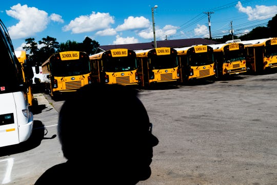 Bill Gentry walks through the lot at Gentry School Bus Line on 2519 Mitchell Street in Knoxville, Tennessee on Wednesday, July 25, 2018. Some of Gentry's newer school buses have installed security cameras as well as other safety equipment like Zonar.