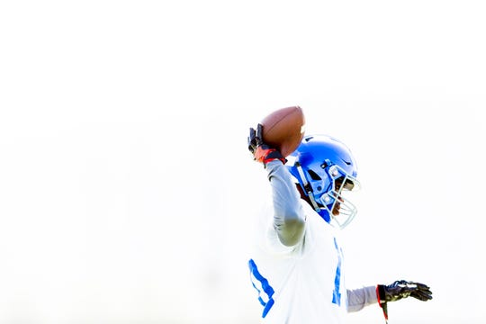 Thomas Harper, Karns senior wide receiver and cornerback, throws the ball during team practice at Karns High School in Knoxville, Tennessee on Wednesday, July 25, 2018. Harper has committed to play for Oklahoma State.