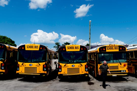 School buses parked at Gentry School Bus Line on 2519 Mitchell Street in Knoxville, Tennessee on Wednesday, July 25, 2018. Some of Gentry's newer school buses have installed security cameras as well as other safety equipment like Zonar.