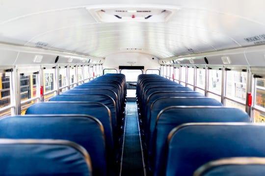 The interior of a school bus at Gentry School Bus Line on 2519 Mitchell Street in Knoxville, Tennessee on Wednesday, July 25, 2018. Some of Gentry's newer school buses have installed security cameras as well as other safety equipment like Zonar.