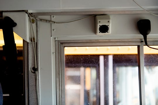 A security camera above the drivers seat of a school bus at Gentry School Bus Line on 2519 Mitchell Street in Knoxville, Tennessee on Wednesday, July 25, 2018. Some of Gentry's newer school buses have installed security cameras as well as other safety equipment like Zonar.