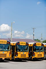 School buses stand parked at Gentry School Bus Line on 2519 Mitchell Street in Knoxville, Tennessee on Wednesday, July 25, 2018. Some of Gentry's newer school buses have installed security cameras as well as other safety equipment like Zonar.