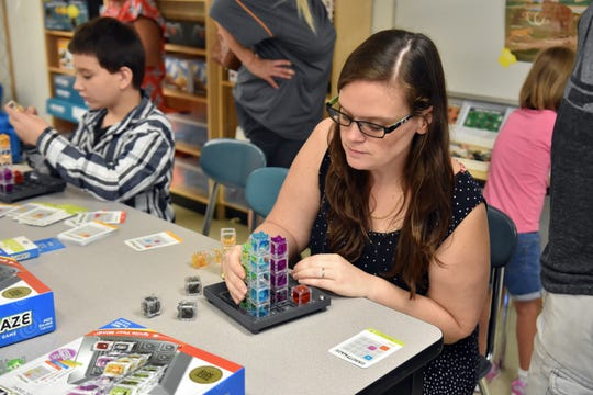 West View fifth-grade science teacher Jessy Heidle works a gravity maze, one of the new activities in the school science lab thanks to a grant from ORAU.