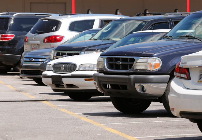 PHOTO ILLUSTRATION--Parking lots big and small often serve as sites of illegal drug sales, based on probable cause affidavits through the years. The deals often are concealed in a sea of cars and SUVs.