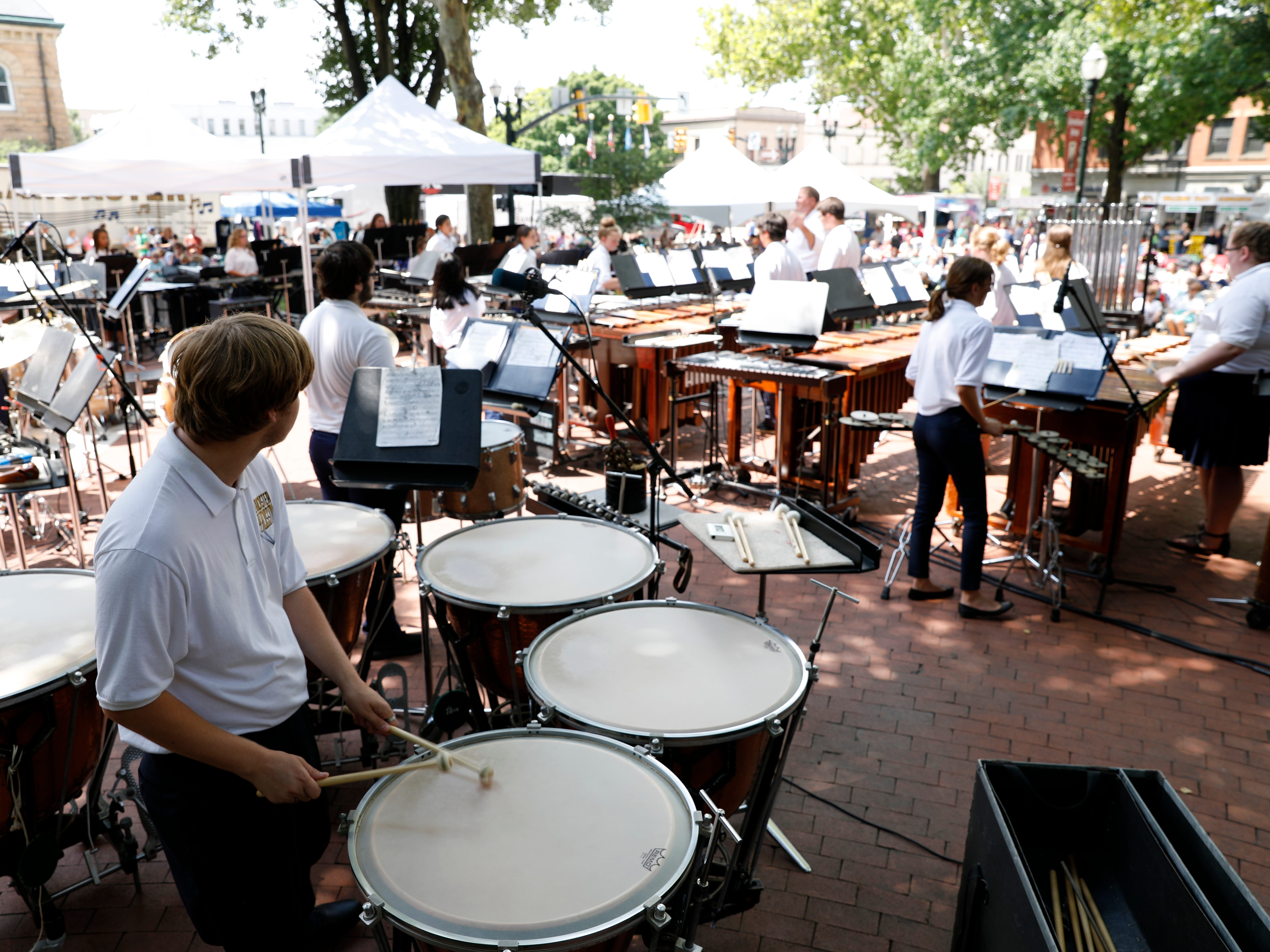 Nich Oettinger plays the timpani Wednesday, July 25, 2018, in downtown Lancater. Oettinger and other members of the Lancaster High School Percussion Ensemble performed a midday concert for the Lancaster Festival.