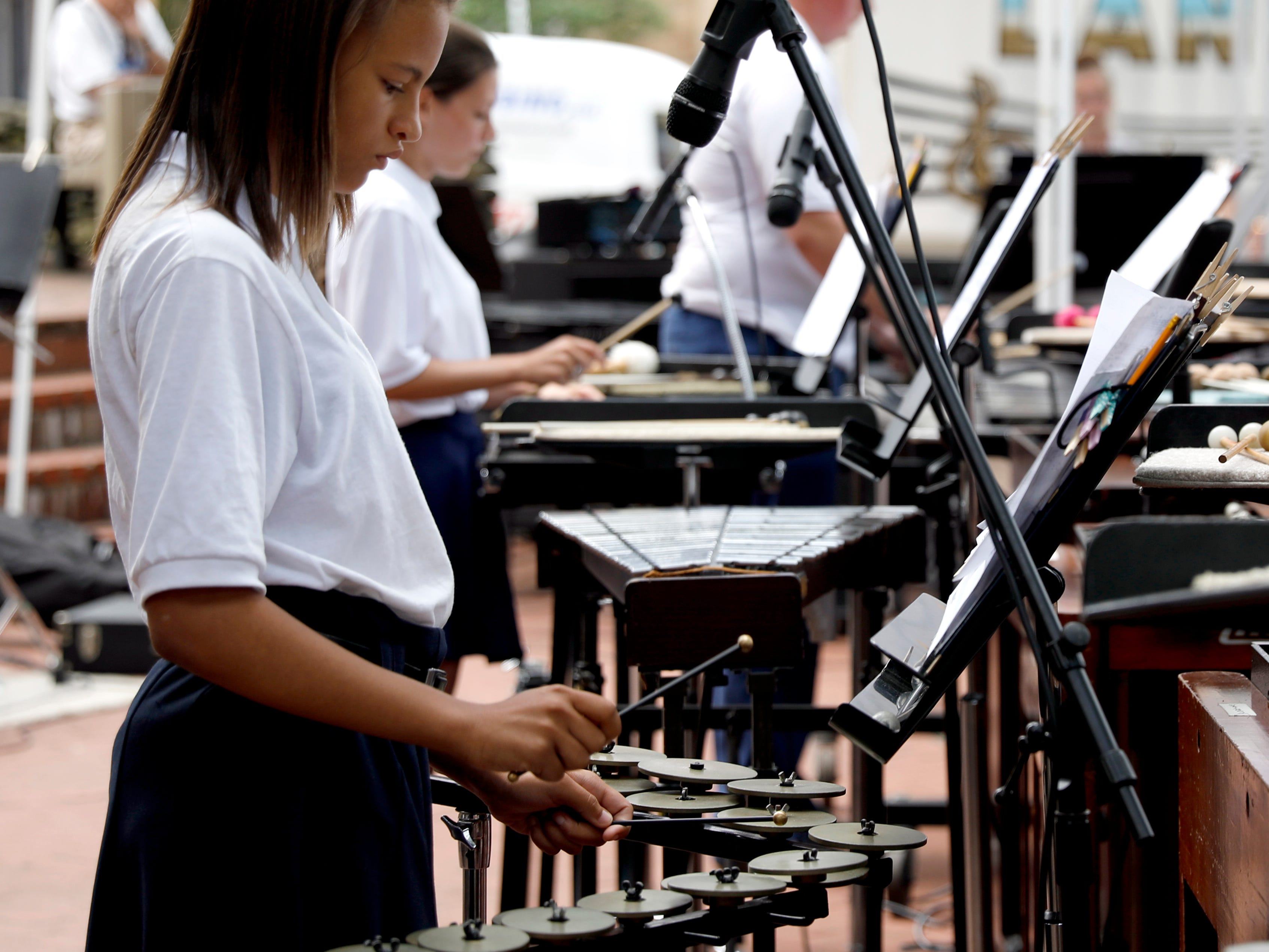 Julianne Callahan performs with the Lancaster High School Percussion Ensemble Wednesday, July 25, 2018, during a midday Lancaster Festival concert in downtown Lancaster.