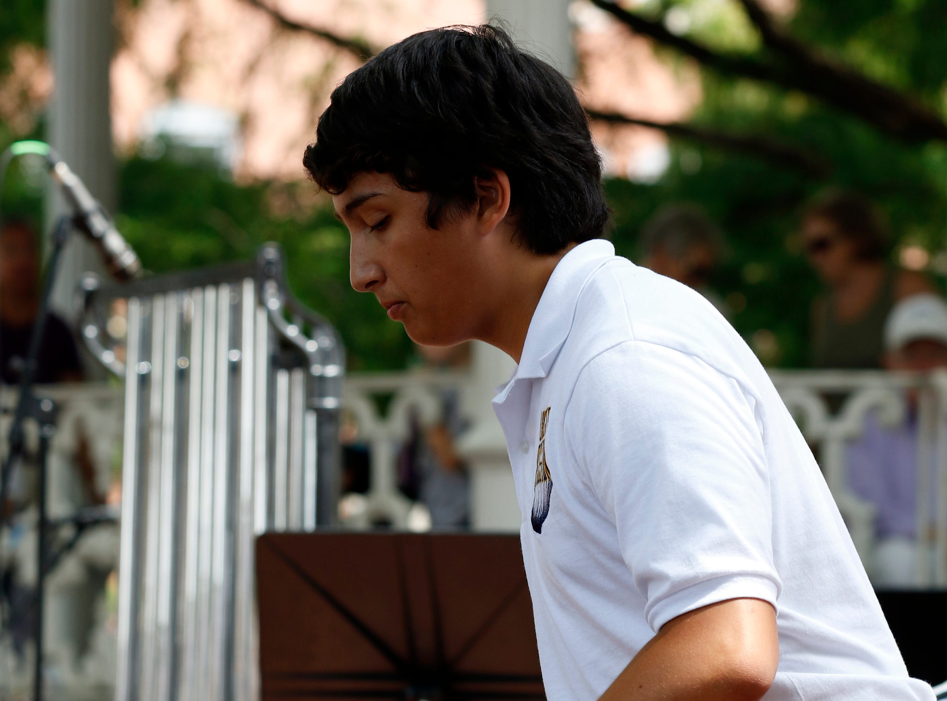 Xander Haroon performs with the Lancaster Percussion Ensemble Thursday, July 25, 2018, during a midday Lancaster Festival Concert in downtown Lancaster.