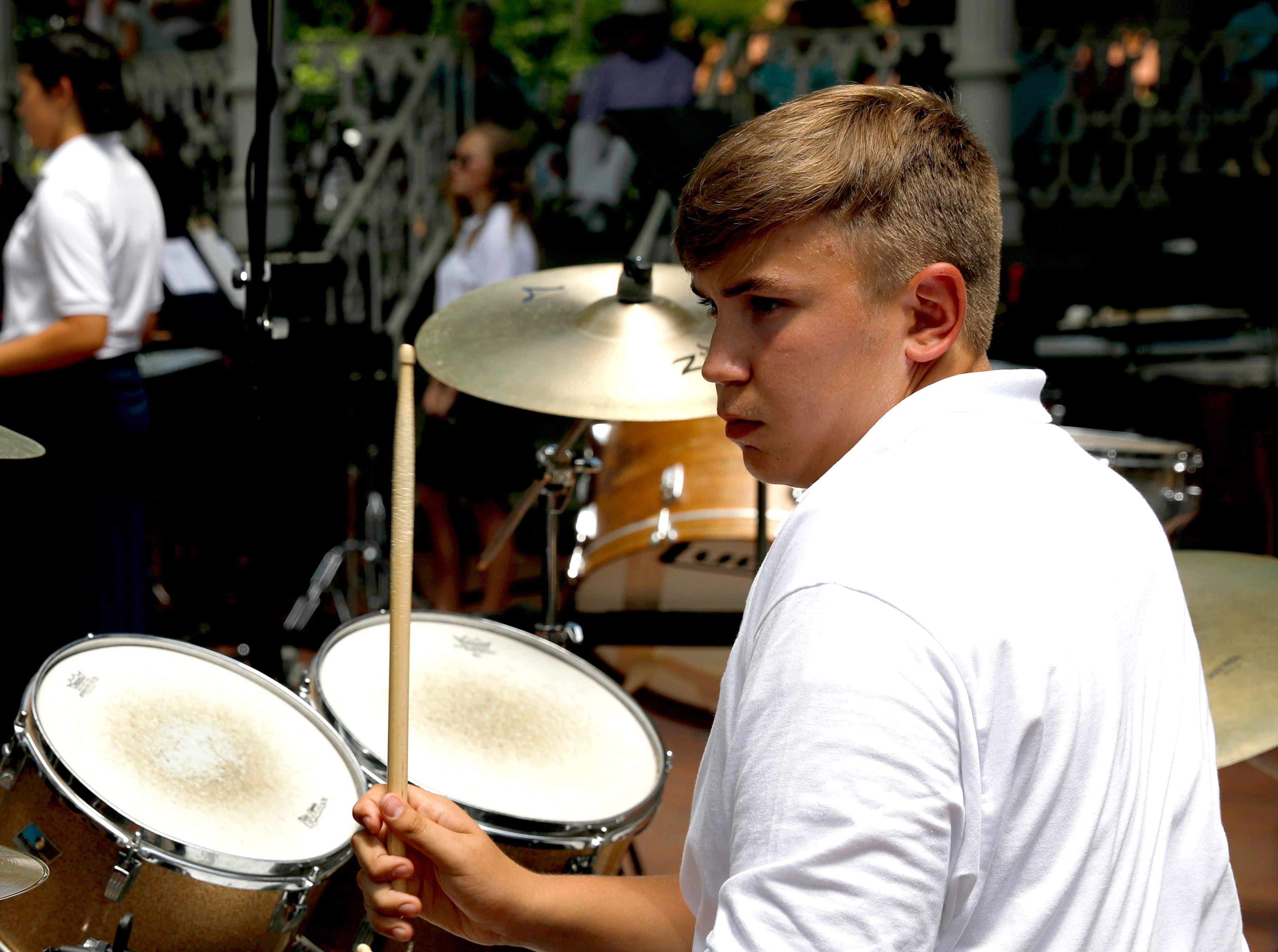 Justice Courtney plays with the Lancaster High School Percussion Ensemble Wednesday, July 25, 2018, during a midday Lancaster Festival concert in downtown Lancaster.