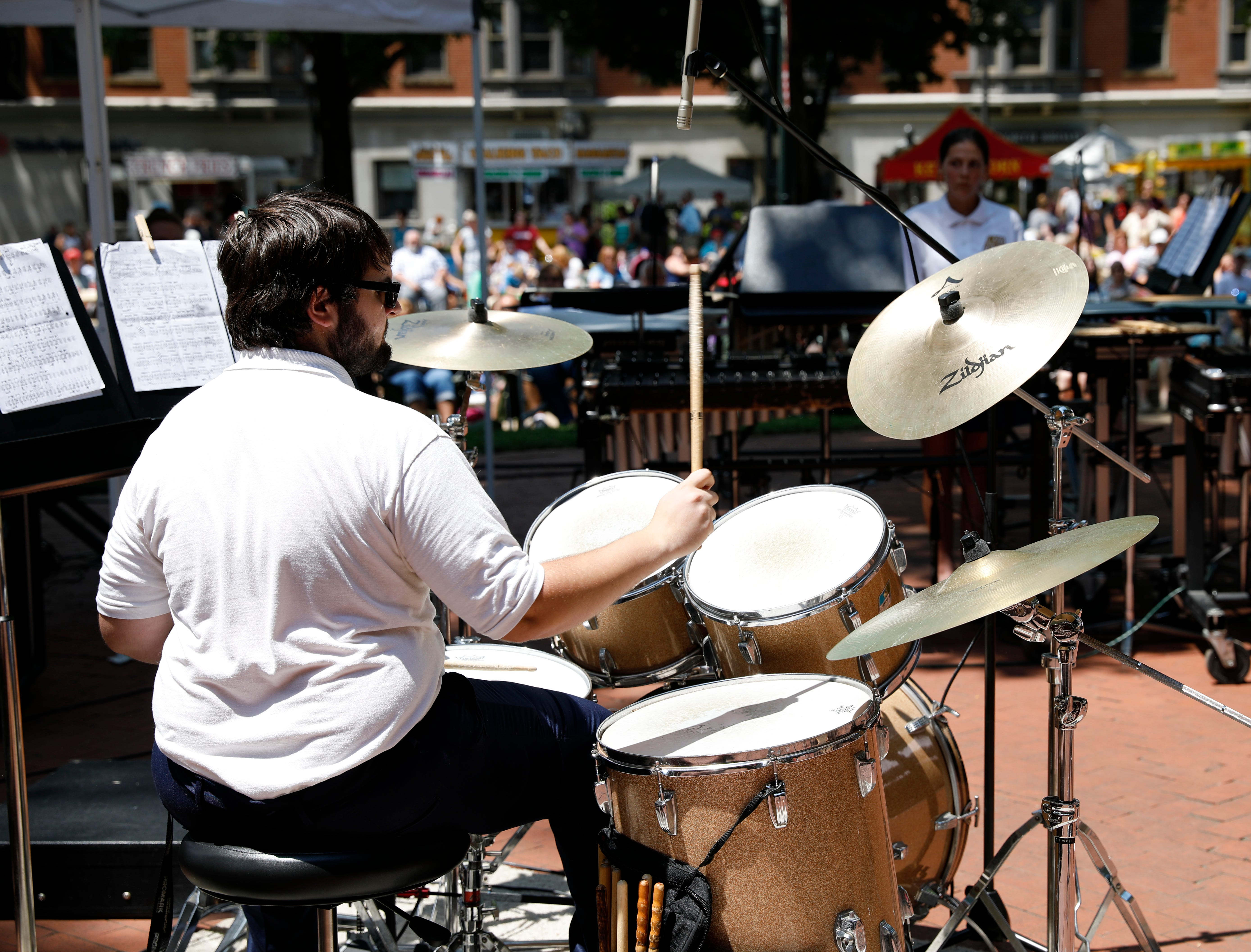Zach Dwyer performs with the Lancaster High School Percussion Ensemble Wednesday, July 25, 2018, during a midday Lancaster Festival concert in downtown Lancaster.
