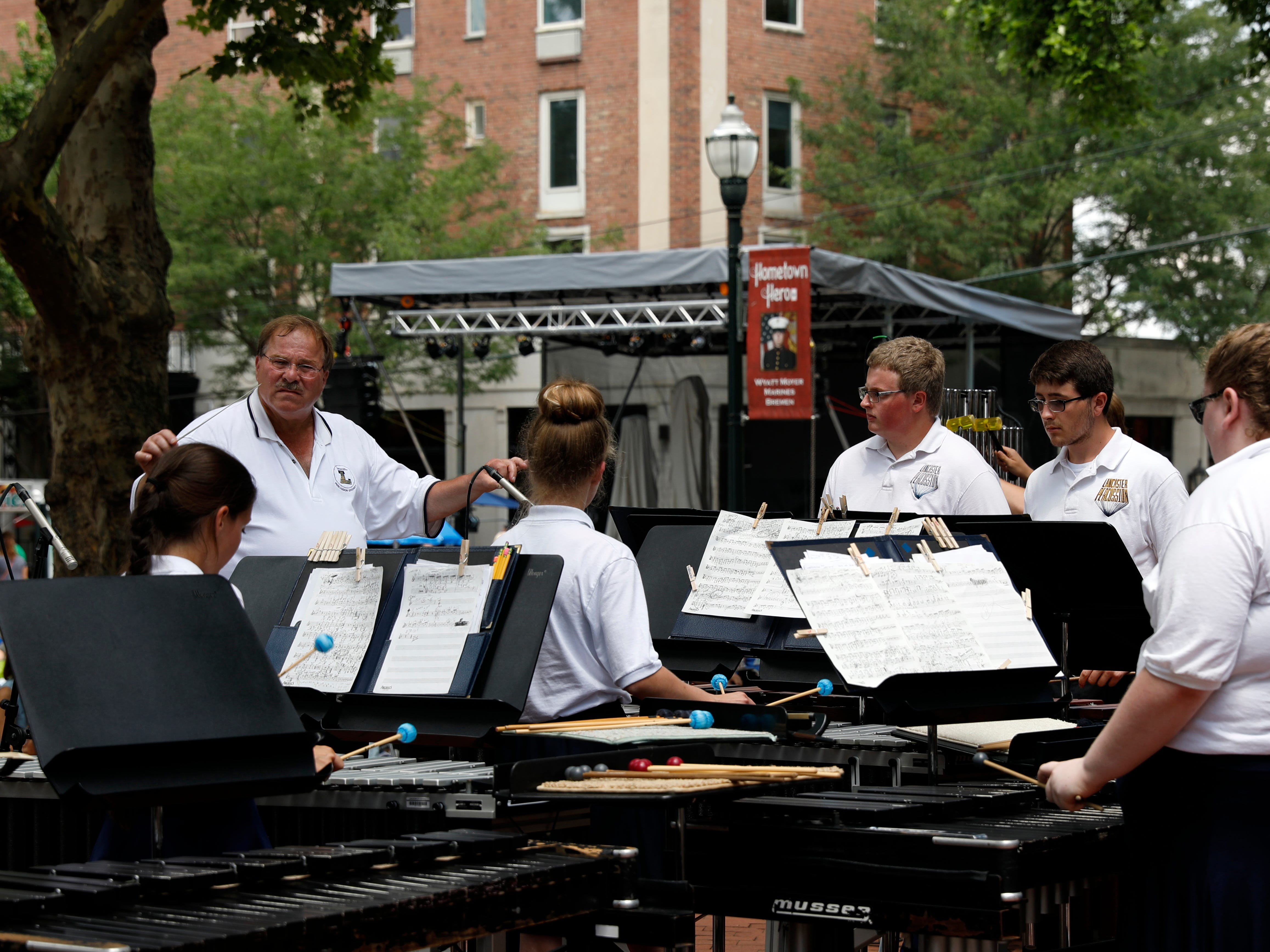 Bruce Gerken leads the Lancaster High School Percussion Ensemble Wednesday, July 25, 2018, during a midday Lancaster Festival concert in downtown Lancaster.