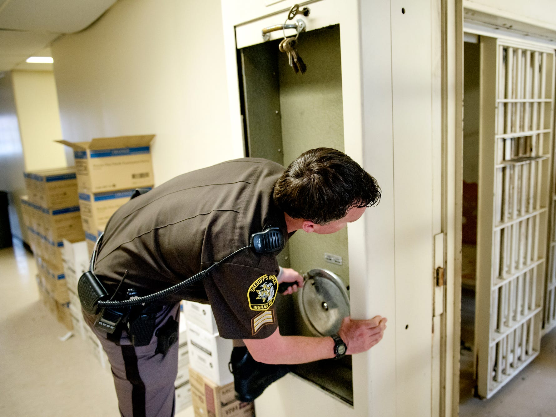 Ingham County Sheriff Deputy James Every uses an outdated crank system to open cell doors during a tour of the Ingham County Jail on Tuesday, April 24, 2018, in Mason.
