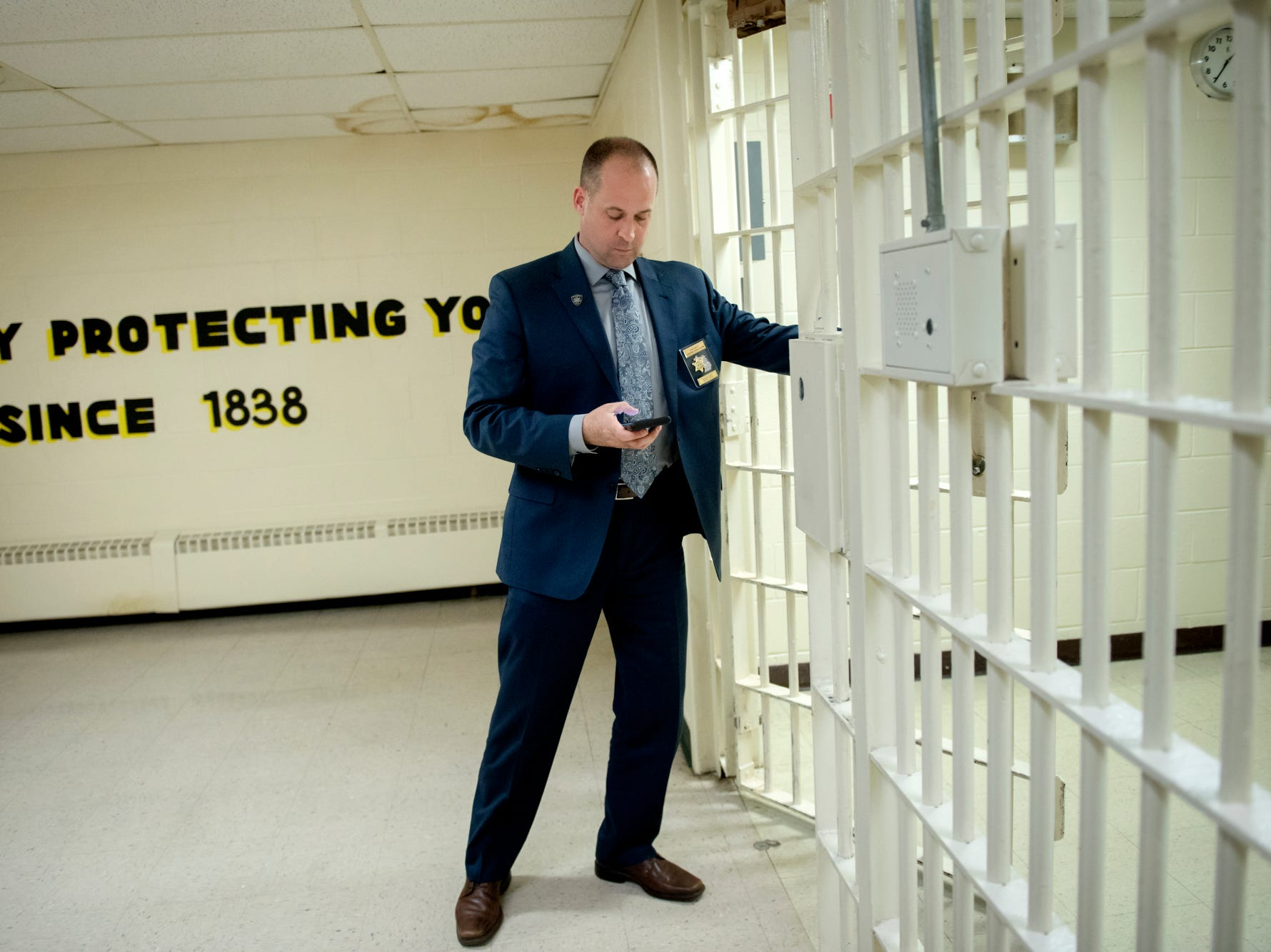 Ingham County Sheriff Chief Deputy Jason Ferguson opens a door during a tour of the Ingham County Jail on Tuesday, April 24, 2018, in Mason.