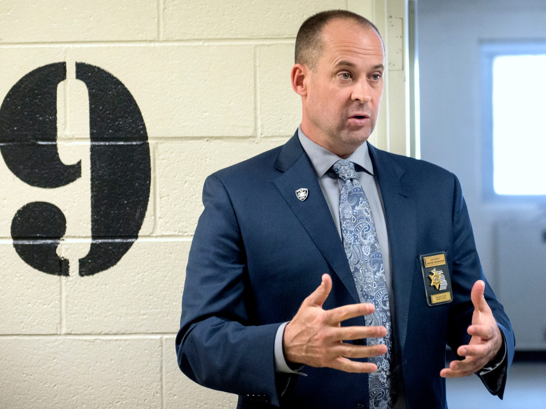 Ingham County Sheriff Chief Deputy Jason Ferguson speaks about post nine at the Ingham County Jail on Tuesday, April 24, 2018, in Mason. Post nine is the only area in the jail where female inmates are housed.