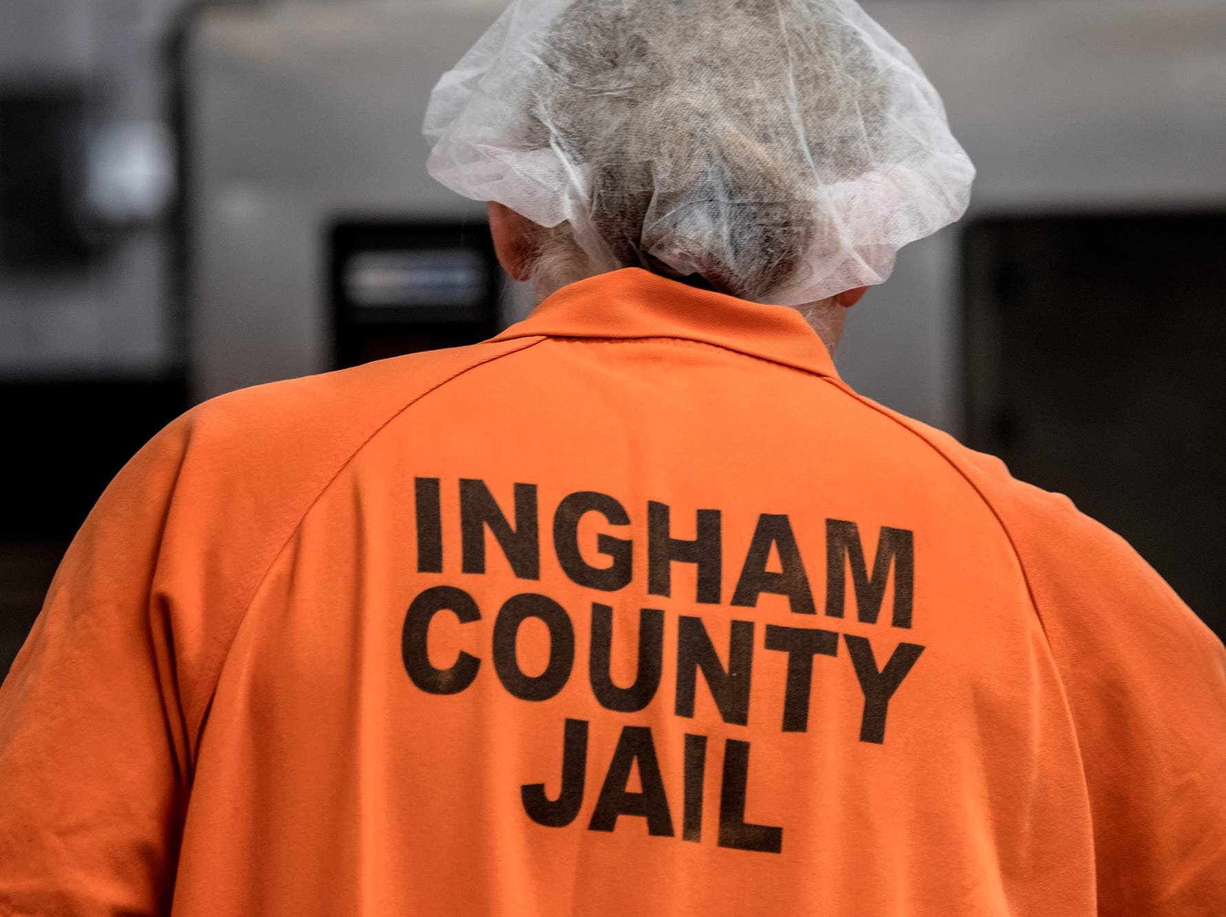 An inmate works in the kitchen during a tour of the Ingham County Jail on Tuesday, April 24, 2018, in Mason.