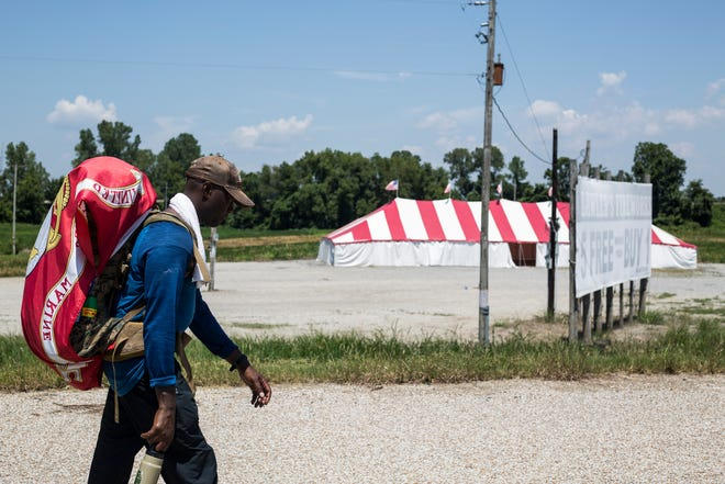 Retired Gunnery Sgt. Roy Wesley Brady, Jr., makes his way towards the Mississippi River on July 25 while walking towards Memphis during his walk across the United States.