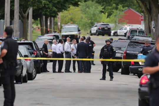 Police investigate at the scene of the homicide of a Milwaukee police officer in July 2018.