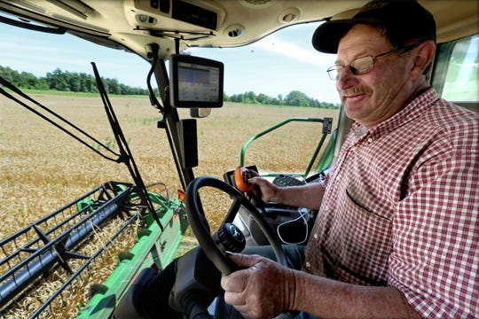 Bob Roden combines a field of winter wheat on his family's farm, Roden Echo Valley LLC, in the West Bend area. They milk 700 cows on any given day and have 1,800 acres of corn, soybeans, winter wheat and alfalfa that they cultivate.