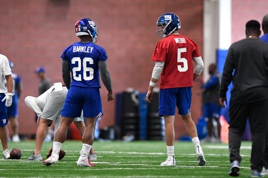 New York Giants running back Saquon Barkley (26) talks to quarterback Davis Webb (5) during the first day of NFL training camp in East Rutherford, NJ on Wednesday, July 25, 2018.