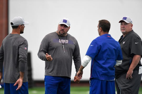 New York Giants defensive coordinator James Bettcher, second from left, speaks with assistant coaches during the first day of NFL training camp in East Rutherford, NJ on Wednesday, July 25, 2018.