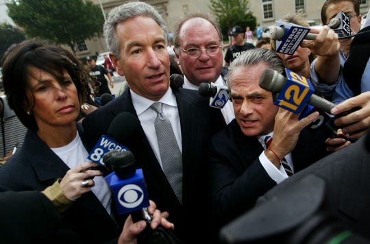 NEWARK, NJ - AUGUST 18:  Charles Kushner (C) wades though the media with his legal team and wife to the  U.S. District Courthouse  August 18, 2004 in Newark, NJ.   Kushner, a New Jersey developer and a major campaign contributors to Democrats including embattled Gov. Jim McGreevey is expected to plead guilty to federal charges that he hired a prostitute to try to silence a witness in a federal investigation.  (Photo by Chris Hondros/Getty Images)