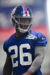 New York Giants running back Saquon Barkley (26) on the field during the first day of NFL training camp in East Rutherford, NJ on Wednesday, July 25, 2018.