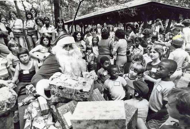 July 26, 1977: Santa Claus came to Van Saun Park in Paramus along with the summer cool snap. St. Nick warmly handed out toys and games to about 100 children as part of the United Jersey Bank's 14th annual Christmas in July.