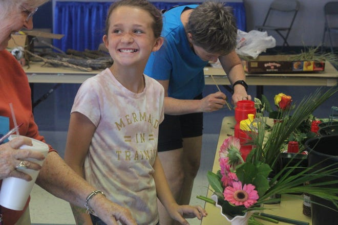 Members of the Artesia Garden Club craft flora arrangements for a competition during the Eddy County Fair, July 25, 2018 at the Eddy County Fairgrounds.