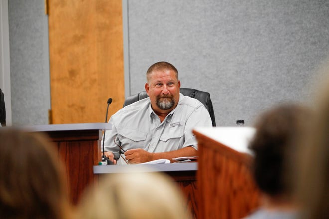 Steve Mueller sits in on a Aztec Commission meeting Tuesday before being appointed the new city manager at Aztec City Hall.