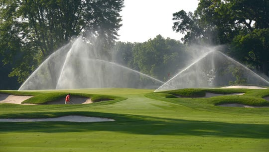 Grounds crews prepare the South Course of Oakland Hills Country Club for play July 24, 2018.
