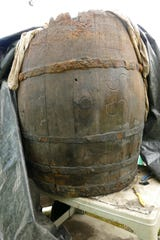 Gulf Power crews working to upgrade the city's downtown power grid discovered a still-intact wooden barrel that formed the base of a well. The barrel was excavated, and University of West Florida researchers are preserving and studying it.