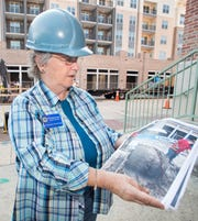 Elizabeth Benchley, of the University of West Florida's Archaeology Institute, shows a photograph of the barrel used for a barrel well recently discovered along Jefferson Street as Gulf Power continues its utility work in downtown Pensacola.  July 25, 2018.