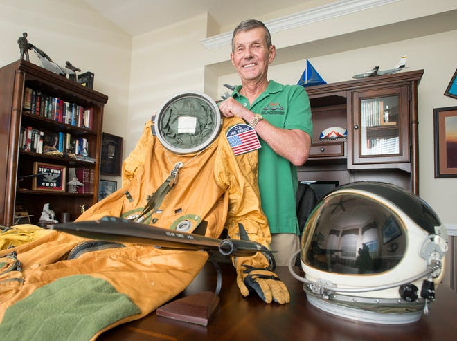 Retired U.S. Air Force Col. Joe Kinego poses with a helmet and pressure suit used to fly the SR-71aircraft at his home in Gulf Breeze on Wednesday, July 25, 2018.  Kinego is donating this pressure suit to a museum in Kansas.