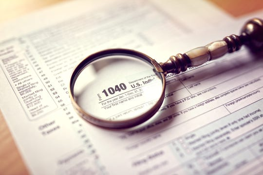 Look for excess cash by reviewing interest listed on Schedule B of form 1040. Too much cash could be a sign you invest too conservatively.