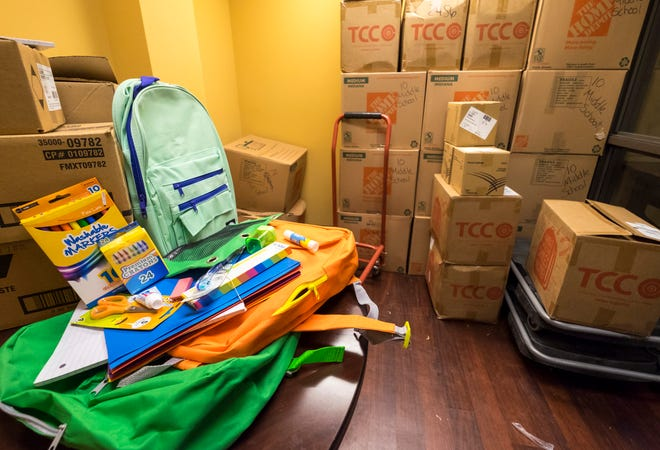 Boxes full of backpacks and school supplies are stacked inside  Blue Water Community Action Wednesday, July 25, 2018. The organization usually gives away between 1,500 and 2,000 backpacks full of school supplies to students in St. Clair County during its annual backpack giveaway.