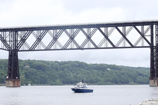 A New York State Police boat searches for a lost swimmer between the Hudson River between the Mid-Hudson Bridge and the Walkway Over the Hudson on July 25, 2018.