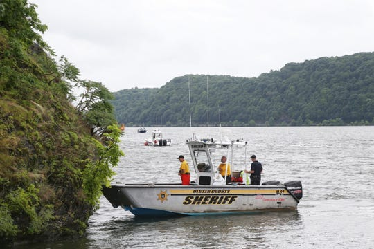 Boats from New York State Police, Dutchess and Ulster County sheriffs departments search the waters between the Mid-Hudson bridge and the Walkway Over the Hudson on July 25, 2018. A swimmer went missing in the Hudson River Tuesday and multiple departments continue the search.