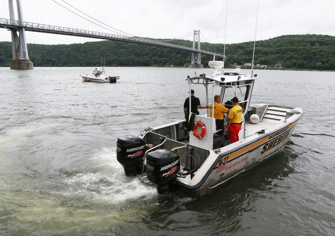 Boats from Dutchess and Ulster County sheriffs departments search the waters between the Mid-Hudson bridge and the Walkway Over the Hudson on July 25, 2018. A swimmer went missing in the Hudson River Tuesday and multiple departments continue the search.