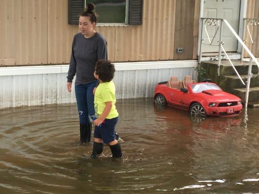 Flooding Boy And Mom