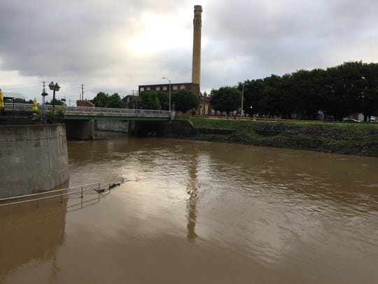 The Codorus Creek rises near Foundry Park in York after heavy rains in July. Plans are in the works to make the Codorus more walkable, more accessible, better lit and overall more aesthetically pleasing. Designs would take into account the creek's flood capacity.